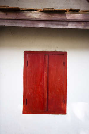 Old red window in laos photo