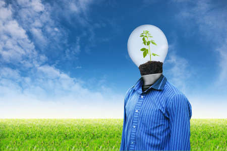 Light man on grass sky background photo