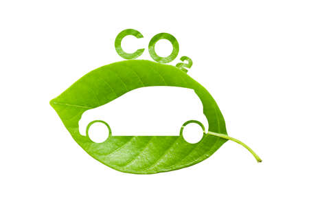 car leaf: green leaf with a cut out car and co2 symbol, save the earth concept