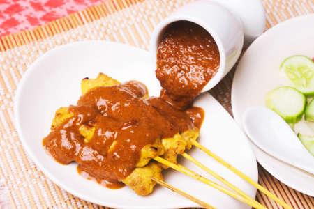 peanut sauce: Grilled Pork Satay with Peanut Sauce and Vinegar Stock Photo
