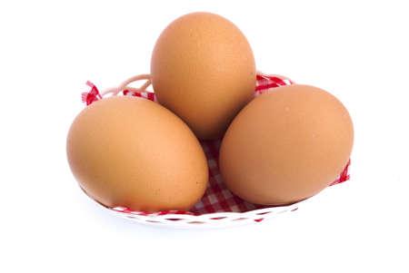 Three eggs in basket photo