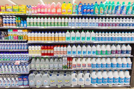 Rome / Italy. December 05, 2018: Shelving with products of different nature, variety of food displayed on the shelves inside a MA supermarket in Rome in Italy. Home hygiene and home cleaning.