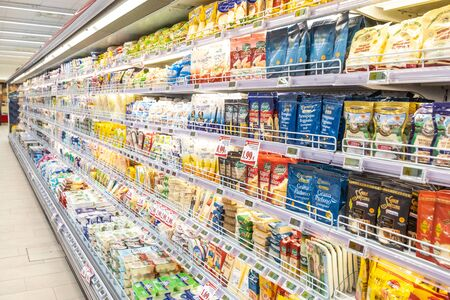 Rome / Italy. December 05, 2018: Shelving with products of different nature, variety of food displayed on the shelves inside a MA supermarket in Rome in Italy. Refrigerators with food and dairy products. Reklamní fotografie