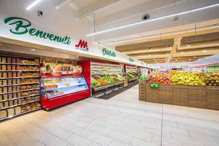 Rome / Italy. December 05, 2018: Shelving with fruit and vegetable department displayed on the shelves inside a MA supermarket in Rome in Italy.