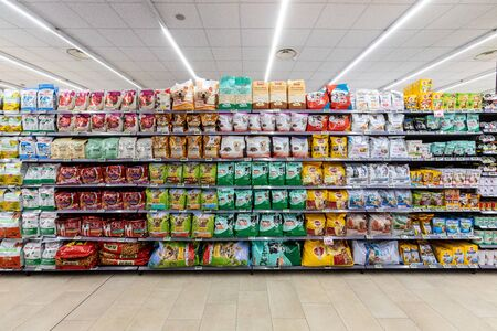 Rome / Italy. December 05, 2018: Shelving with products of different nature, variety of food displayed on the shelves inside a MA supermarket in Rome in Italy. Pet food.