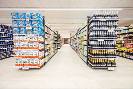 Rome / Italy. December 05, 2018: Shelving with products of different nature, variety of food displayed on the shelves inside a MA supermarket in Rome in Italy. Snacks and beer. Reklamní fotografie