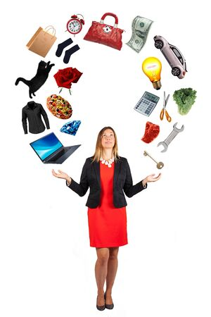Woman with a lot of objects flying above her. Desires and dreams. White backgorund. A beautiful woman has in her hands the objects of her desires and dreams. The female can handle everything with complete mastery and ability. White background.
