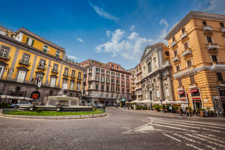 Naples, Italy. August 09, 2015: Square and city life in the historic center of Naples in Italy. Piazza Trieste e Trento with the historic Carciofo Fountain.