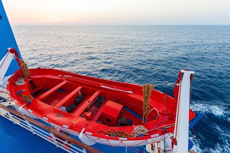 Tourism ship, ferry from Piombino in Italy to Bastia in Corsica in France. Detail of the lifeboat, in the open sea, deep blue color. Foto de archivo