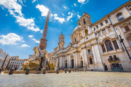 Rome, Italy. May 25, 2020: Santa Agnese in Agone, 17th-century Baroque church in Rome, Italy and Fontana dei Quattro Fiumi Fountain of the Four Rivers. Blue sky.
