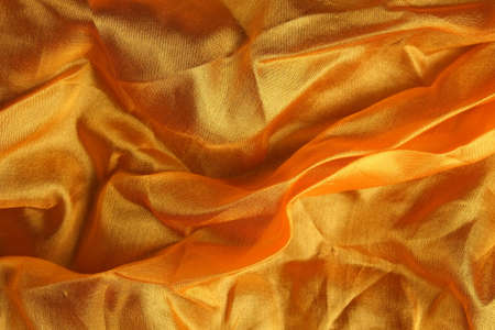 Smooth and shiny golden silk handkerchief Фото со стока