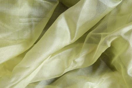 Smooth and shiny yellow silk handkerchief