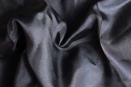 Smooth and shiny black silk handkerchief