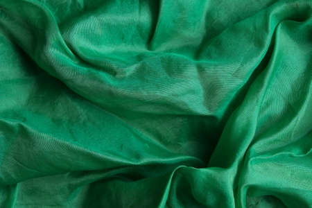 Smooth and shiny green silk handkerchief