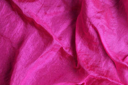 Smooth and shiny fuchsia pink silk handkerchief Фото со стока