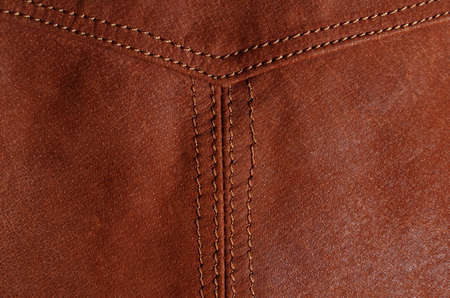 Detail picture of nylon seam in a brown leather jacket