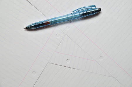 Writing pen on top of several sheets of paper. Education and learning. (horizontal position)