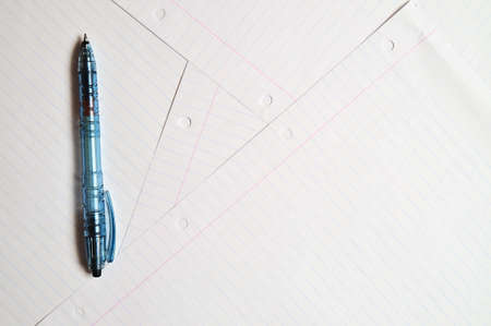 Writing pen on top of several sheets of paper. Education and learning photo