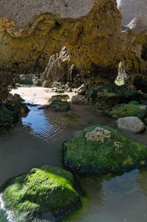 Scene captured in Chiringuitos beach (also called Gale beach), Albufeira. Algarve, Portugal Фото со стока - 84407712