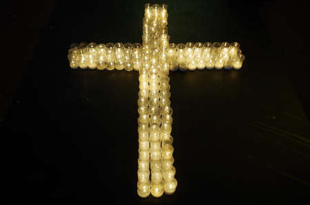Cross made with candles. Religion and spirituality Фото со стока - 82728900