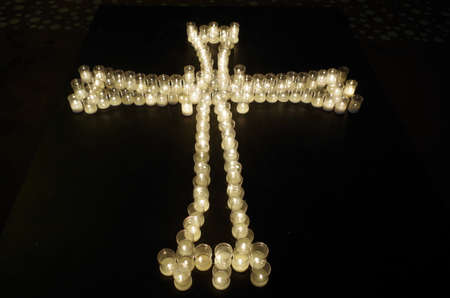 Cross made with candles. Religion and spirituality Фото со стока - 82728996