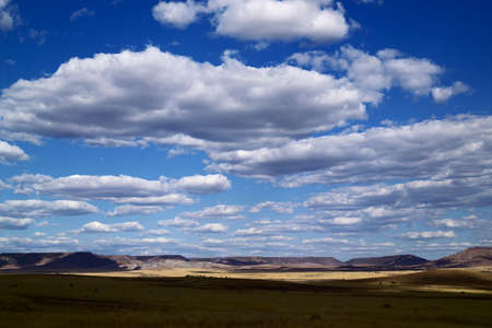 desert landscape whit blue sky and clouds photo