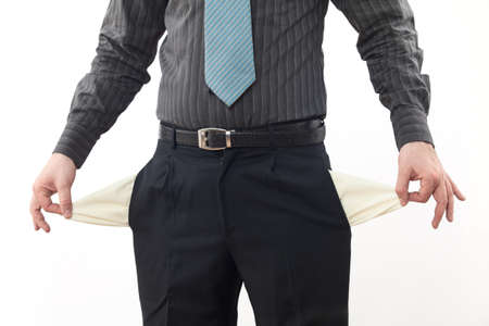 Bankrupt business person with empty pockets photo