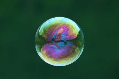 Soap bubbles on water natural background photo