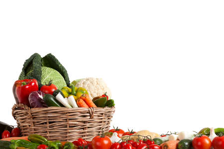 Composition with raw vegetables in wicker basket isolated on white photo