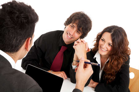Young married couple at desk in a business meeting photo