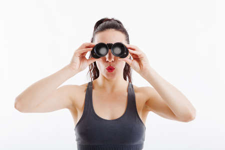 woman searching: beautiful woman searching with binoculars and looking surprised