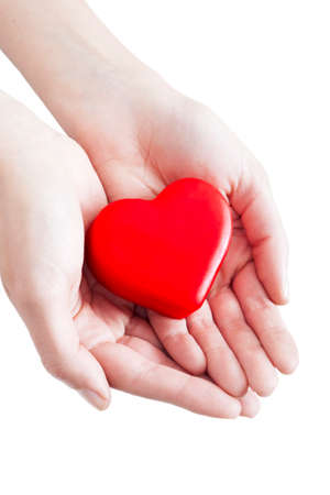 charity  symbol: Red heart in man hands, isolated on white
