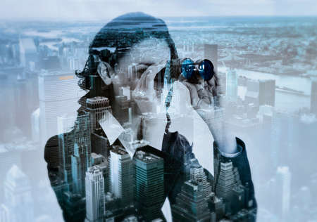 megalopolis: double exposure of businesswoman with binocular and megalopolis, colored effect