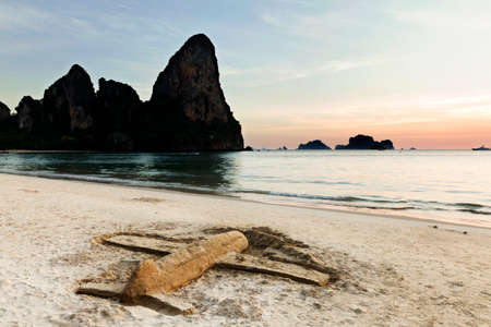 airplane landing: sand model Airplane landing on sunset tropical beach, Railay, Thailand