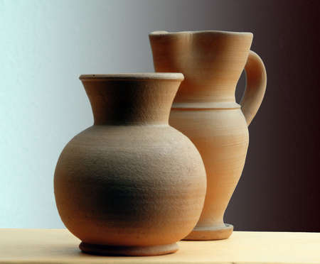 Two classic terracotta vase on a shade background Stock Photo
