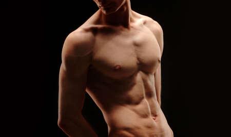 Bodybuilder-body part on black background Stock Photo