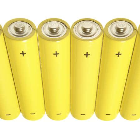 Yellow batteries over white Stock Photo