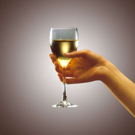wine glass in womans hand Stock Photo