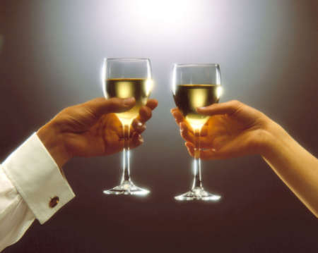 A woman and a man having a toast Stock Photo