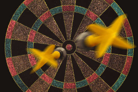 Two darts flying to target photo