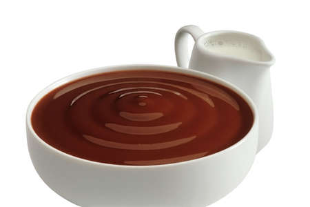 Cup of chocolate cream with milk