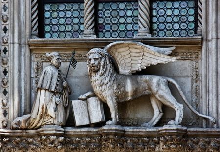 saint mark's: The Venetian lion and Doge on a cathedral building on San Marco square. Venice. Italy.