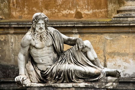 roman catholic: Sculpture of the man semilaying on a bench in a court yard of Vatican.