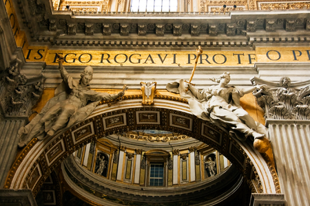 Arch with sculptures in St. Peters Cathedral photo