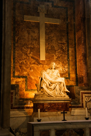 Sculpture of the woman with the child under the big cross in St. Peters Cathedral