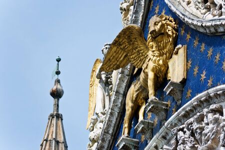 The Venetian lion on a cathedral building on San Marco square. Venice. Italy. Stock Photo - 1512275
