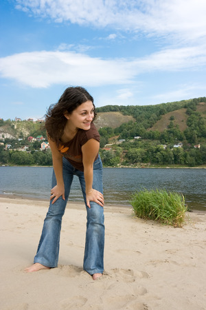 The happy beautiful girl on the river photo
