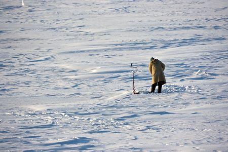 Winter fisherman on the frozen Volga river. Stock Photo - 2298127