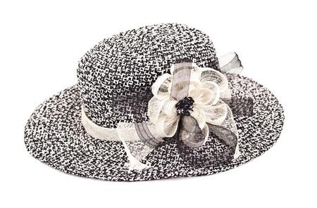Mooie vrouw hoed met band en bloem geïsoleerd op witte achtergrond Stockfoto