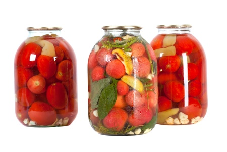 pickled: Preserved red tomatoes in a glass jar isolated on white background